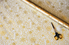 Gold Christmas gift wrap and scissorss Stock Image