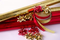 Christmas wrapping paper. Wrapping paper, tape and shiny stars for wrapping presents Stock Image