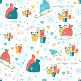 Christmas wrapping paper background with box of gifts and Santa sledge. Royalty Free Stock Images