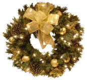 Christmas Wreath. Isolated view of a lighted and decorated gold and green wreath Royalty Free Stock Image