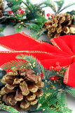 Christmas Wreath. With pine cones and a red bow stock photography