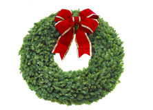 Christmas wreath. With bright red bow on white background stock photography
