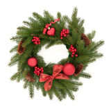 Christmas Wreath. Made of blue spruce pine with red bauble decorations, berry clusters, pine cones and bow isolated over white background stock photography