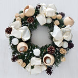 Christmas wreath. With natural earthy pine cones and wooden baubles Royalty Free Stock Images