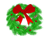 Christmas Wreath. A pine wreath decorated for Christmas with pinecones and a red bow Stock Photography