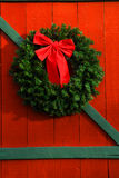 Christmas Wreath. Beautiful Christmas wreath hangs on a wooden door Royalty Free Stock Photography