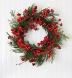 Christmas wreath. Of berries and evergreen royalty free stock image