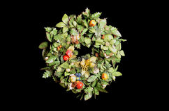 Christmas wreath. Artificial Christmas wreath with decoration of fruits and ornaments stock photo