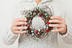 Christmas wreath. Decorative Christmas wreath held in hands of a man royalty free stock images