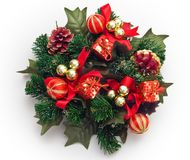 Christmas wreath. Decoration with red and golden balls, red little gifts royalty free stock photos