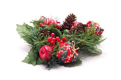Christmas wreath. A Christmas wreath with red small apples and a pine cone isolated on white background Stock Image