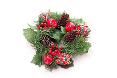 Christmas wreath. A Christmas wreath with red small apples and a pine cone isolated on white background Royalty Free Stock Image