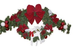 Christmas Wreath. A christmas wreath with red laces, a snow rain deer, white and red balls Royalty Free Stock Image