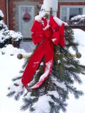 Christmas Wreath. Christmas decoration in front of house in snow royalty free stock photography