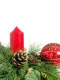 Christmas wreath. Christmas - wreath from fresh twigs and cones with red candle stock images