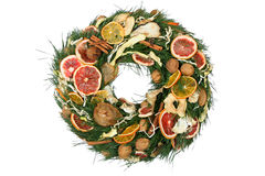Christmas wreath. Isolated Christmas wreath made od fruits and spices royalty free stock photos