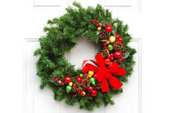 Christmas Wreath. A traditional festive Christmas wreath hanging on a doorway Royalty Free Stock Images