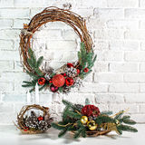 The Christmas wreath. Against a white brick wall Royalty Free Stock Image