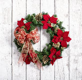 Christmas wreath against white wood Stock Photos