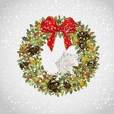 Christmas wreath with apples cones holly and bow. Evergreen christmas wreath with apples cones holly and bow Royalty Free Stock Photos