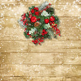 Christmas wreath with apples and red berries on a vintage wooden Royalty Free Stock Photography