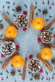 Christmas wreath arrangement of pine cones, oranges, and spices stock images