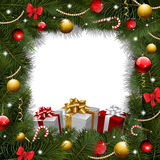 Christmas wreath background with gifts Stock Photography