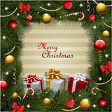 Christmas wreath background with gifts Stock Photo
