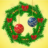 Christmas wreath with balls and bows. Stock Photos