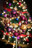 Christmas Wreath with balls. This is a Christmas  wreath with balls. A tree with lights is in the background Stock Photos
