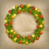 Christmas wreath. Christmas balls on wooden background Stock Photos