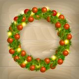 Christmas wreath. Christmas balls on wooden background Stock Image