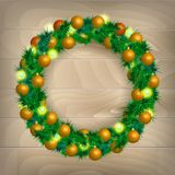 Christmas wreath. Christmas balls on wooden background Stock Photo