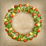 Christmas wreath. Christmas balls on wooden background Stock Photography