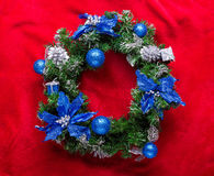 Christmas wreath with baubles on a red Royalty Free Stock Image