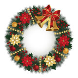Christmas wreath with bells. Fir branches, poinsettia plant and decorative elements Royalty Free Stock Photo