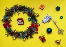 Christmas wreath with bells, toys and presents Stock Photo