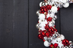 Christmas wreath with bells on wooden background Stock Image