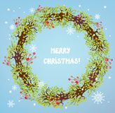 Christmas wreath with berries and snow Royalty Free Stock Image
