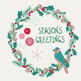 Christmas wreath with bird and decorations Royalty Free Stock Photos