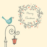 Christmas wreath with bird on the old street light. Vintage New Year and Christmas element. Christmas greeting card. Stock Images