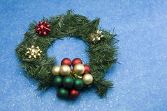 Christmas wreath on blue bkgd Stock Photo