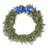 Christmas wreath with blue bow Stock Photos