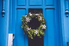 Christmas Wreath on Blue Door in Gent Royalty Free Stock Photo