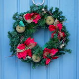 Christmas Wreath on Blue Door Royalty Free Stock Photography