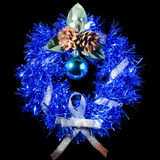 Christmas wreath. Blue Christmas wreath with ribbon, cones and Christmas toys. Insulation Stock Image