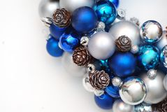 Christmas Wreath blue and Silver Balls or Cristmas Globes Decorated with Pinecones. Isolated with Copy Space. Christmas Wreath blue and Silver Balls or Cristmas stock photos