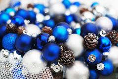 Christmas Wreath blue and Silver Balls or Cristmas Globes Decorated with Pinecones. Isolated with Copy Space. stock photography