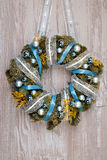 Christmas wreath with blue and silver decorations on wood Royalty Free Stock Images