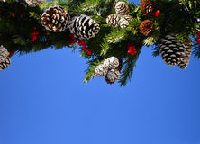 Christmas wreath and blue sky Royalty Free Stock Images